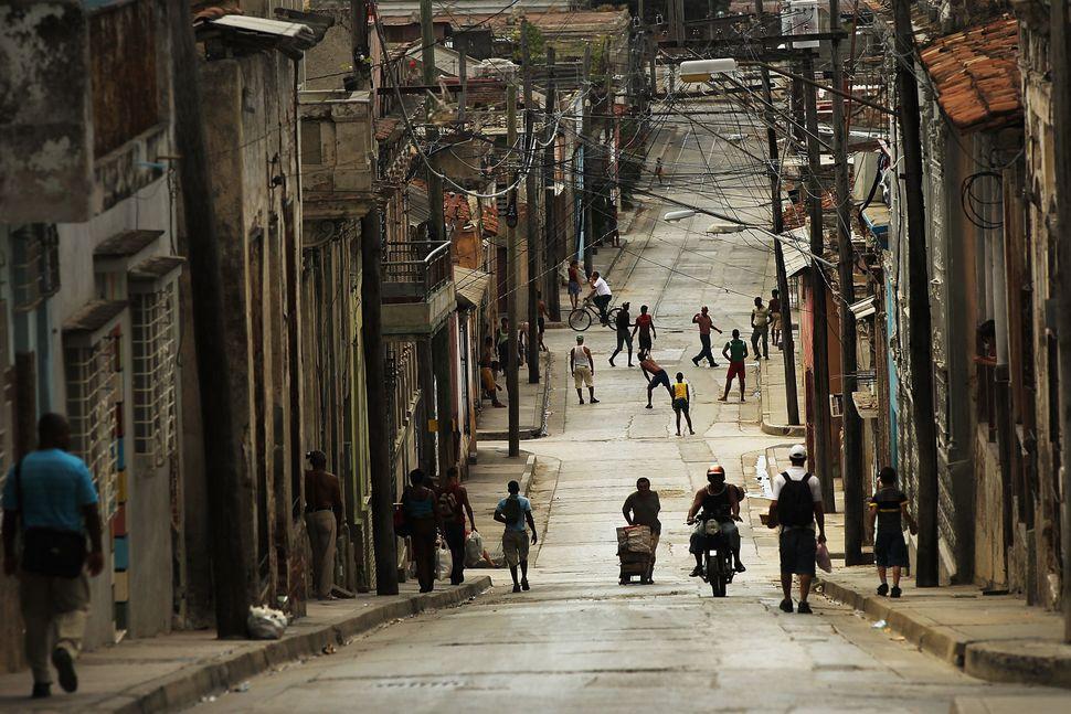 2012 - People fill the street in a busy downtown neighborhood in Santiago de Cuba.