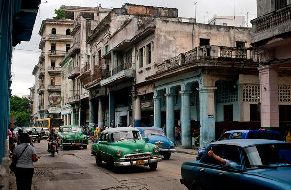 2012 - Cars drive down a street in Havana.