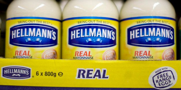 Jars of Hellmann's mayonnaise, produced by Unilever Plc., stand on display at a supermarket in London, U.K., on Friday, July