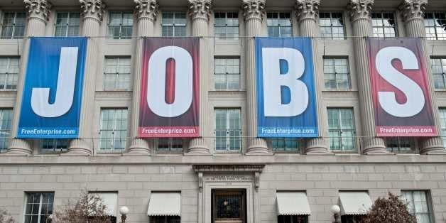 A banner reading 'Jobs' hangs on thre facade of the US Chamber of Commerce in Washington,DC on February 22, 2011. New claims