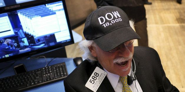"Peter Tuchman wears a ""DOW 18,000"" hat on the floor at the New York Stock Exchange in New York, Tuesday, Dec. 23, 2014. U.S."