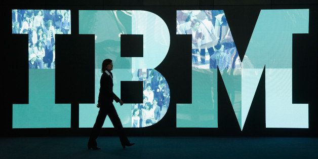 HANOVER, GERMANY - FEBRUARY 28:  A woman walks past the IBM logo at the CeBIT technology trade fair the day before the fair's