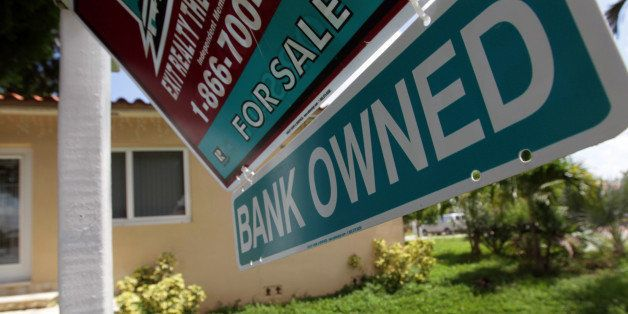MIAMI - SEPTEMBER 16:  A Bank Owned sign is seen in front of a foreclosed home on September 16, 2010 in Miami, Florida. Realt