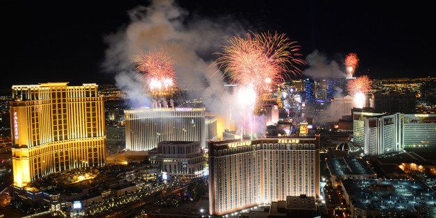 In this photo provided by the Las Vegas News Bureau, fireworks burst over the Las Vegas Strip at midnight on New Year's 2014,