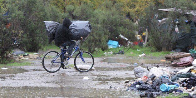With AFP Story by Veronique DUPONT: US-Poverty-Homeless-Technology A man rides along a muddy path carrying his belongings at the Silicon Valley homeless encampment known as 'The Jungle' on Wednesday, December 3, 2014 in San Jose, California. More than 300 residents of the shantytown have been given notices to leave the area by the morning of Thursday, December 4, 2014. Many of have nowhere else to go. AFP PHOTO/JOSH EDELSON (Photo credit should read Josh Edelson/AFP/Getty Images)