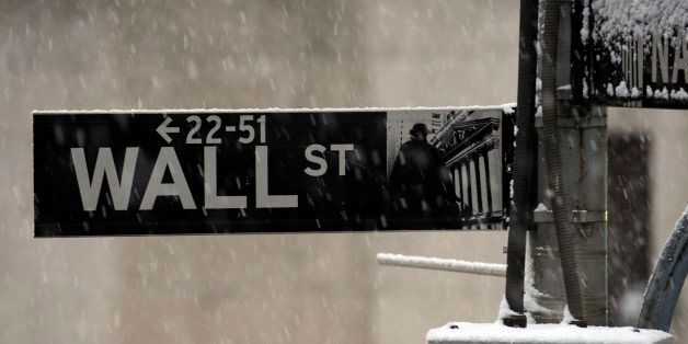 FILE - In this Dec. 31, 2009 file photo, snow falls outside the New York Stock Exchange in New York. The stock market is mana