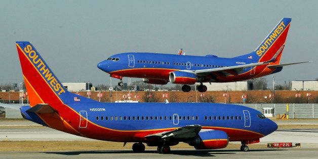 FILE - In this Feb. 9, 2012, file photo, a Southwest Airlines Boeing 737 waits to take off at Chicago's Midway Airport as ano