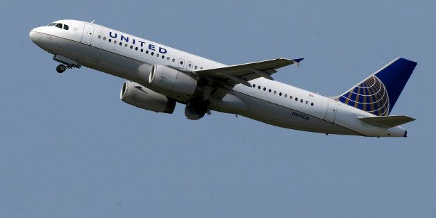 HOLD FOR BUSINESS PHOTO-- This is a United Airlines jet taking off from Pittsburgh International Airport on Tuesday, July 23,
