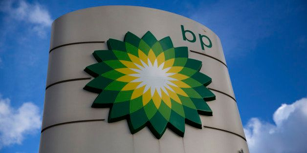 A BP logo is seen outside a petrol station in the town of Bletchley in Buckinghamshire, England, Thursday, Jan. 15, 2015.  BP