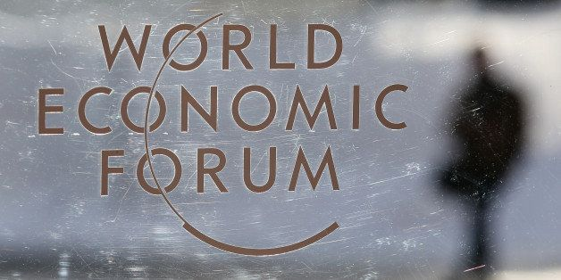 A logo sits on a glass panel inside the Kongress Zentrum, also known as Congress Center, the venue of the World Economic Foru