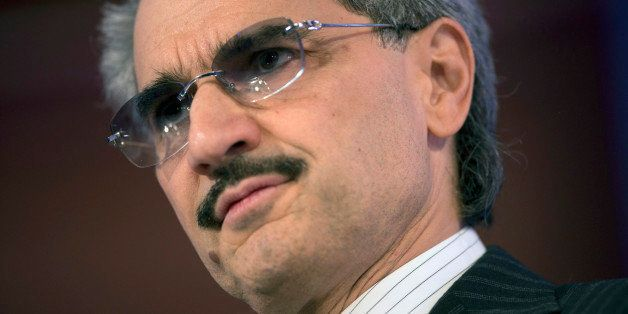 Prince Alwaleed Bin Talal, Saudi billionaire and founder of Kingdom Holding Co., listens at the Bloomberg Year Ahead: 2014 co