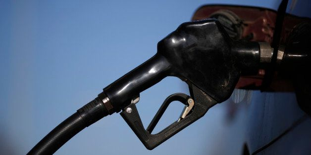 A gasoline nozzle is inserted into a vehicle's gas tank during refueling at a a Royal Dutch Shell Plc gas station in Portland