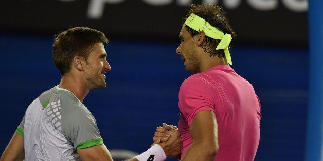 Spain's Rafael Nadal (R) shakes hands after victory in his men's singles match against Tim Smyczek of the US on day three of