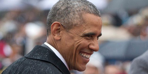 U.S. President Barack Obama smiles in the rain as he arrives for Republic Day in New Delhi, India, Monday, Jan. 26, 2015. Oba