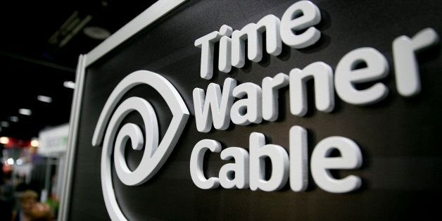 The Time Warner Cable Inc. logo is seen on the exhibit floor during the National Cable and Telecommunications Association (NCTA) Cable Show in Washington, D.C., U.S., on Tuesday, June 11, 2013. The Cable Show is expected to bring in more than 10,000 attendees with 286 companies on the exhibit floor. Photographer: Andrew Harrer/Bloomberg via Getty Images