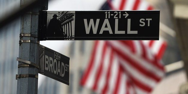 A Wall Street road sign is pictured near the New York Stock Exchange (NYSE) building on October 16, 2014 in New York. US stoc