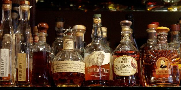 FILE - This Oct. 23, 2014, file photo, shows a selection of bourbons at Daddy-O bar in New York. Producers of Kentucky bourbo