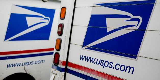 U.S. Postal Service delivery trucks sit at the Brookland Post Office in Washington, D.C., U.S., on Thursday, May 9, 2013. The