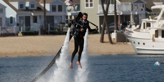 Grant Engler is airborne as he flies in a jet pack suit into his wedding ceremony Thursday, Aug. 23, 2012 in Newport Beach, C