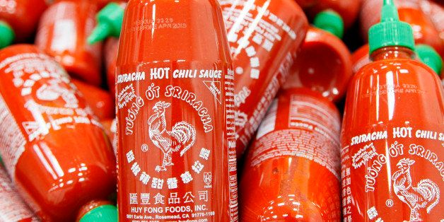 FILE - In this Tuesday, Oct 29, 2013, file photo, Sriracha chili sauce bottles are produced at the Huy Fong Foods factory in