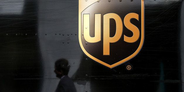 SAN FRANCISCO, CA - JUNE 17:  A pedestrian walks by a United Parcel Service (UPS) truck on June 17, 2014 in San Francisco, Ca