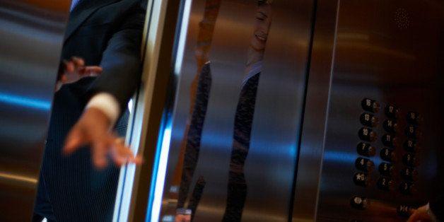 Hands of businessman entering elevator
