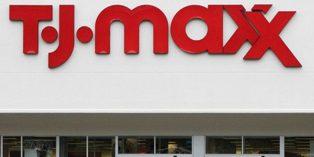 FILE - In this Aug. 16, 2010 file photo, shoppers enter and exit a TJ Maxx store in Barre, Vt. TJX Companies Inc., parent of