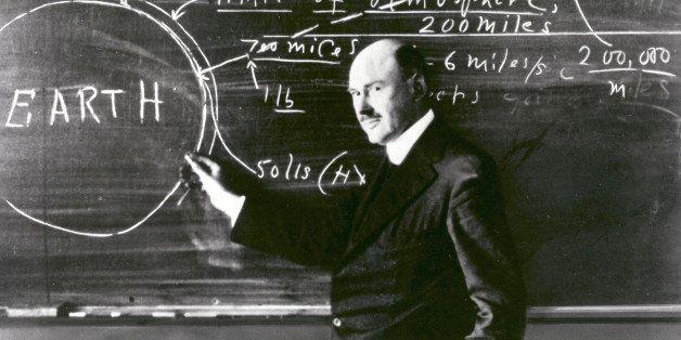 Dr. Robert H. Goddard at a blackboard at Clark University in Worcester, Massachusetts, in 1924. Goddard began teaching physic