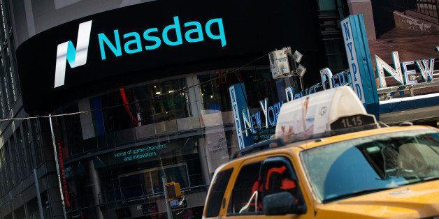 NEW YORK, NY - MARCH 02: Cars drive past the NASDAQ MarketSite on March 2, 2015 in New York City. The NASDAQ composite climbe