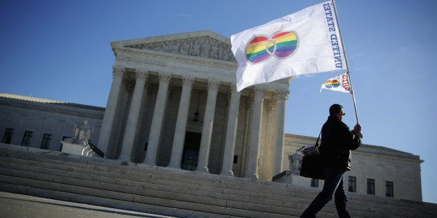 WASHINGTON, DC - JANUARY 09:  Pete Prete of Equality Beyond Gender holds a 'marriage pride flag' outside the U.S. Supreme Cou