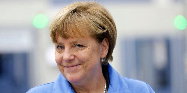 German Chancellor Angela Merkel smiles during her visit to the Siemens electronics manufacturing plant in Amberg, Germany, Mo