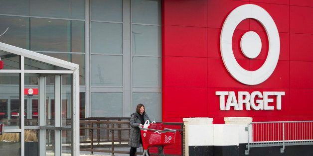 Shopper Laura Steele pushes a shopping cart as she leaves a Target Corp. store in Toronto, Ontario, Canada, on Thursday, Jan.