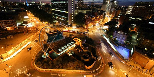 Street lighting illuminates traffic as it moves around the Old Street roundabout, also referred to as 'Silicon Roundabout,' i