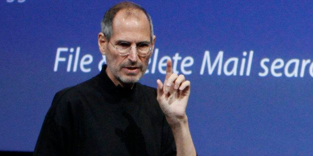 Apple Inc. Chairman and CEO Steve Jobs gestures on stage during an event in Cupertino, Calif., Thursday, April 8, 2010.  (AP