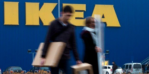 People walk in front of an IKEA shop in Berlin, Friday, Nov. 16, 2012. Swedish furniture giant Ikea expressed regret Friday t