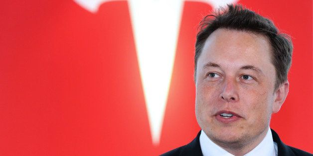Elon Musk, co-founder and chief executive officer of Tesla Motors Inc., attends a key delivery ceremony of the company's prem