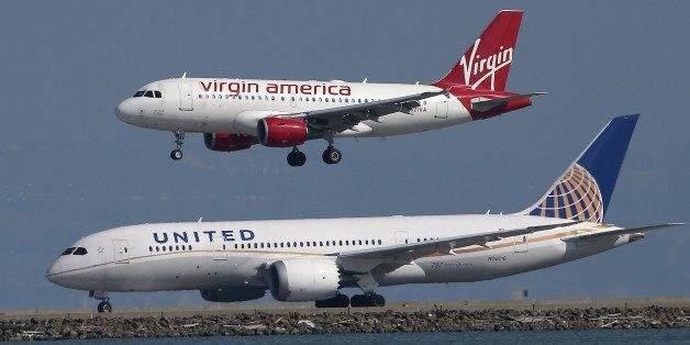 SAN FRANCISCO, CA - FEBRUARY 18:  A Virgin America plane lands above a United Airlines plane at San Francisco International A