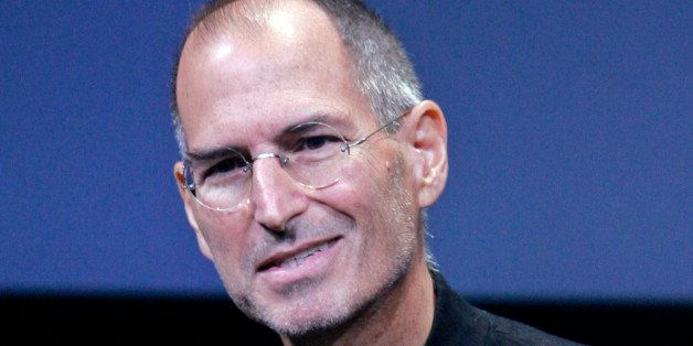 FILE - In this Oct. 14, 2008 file photo, Apple CEO Steve Jobs smiles during a product announcement at Apple headquarters in C
