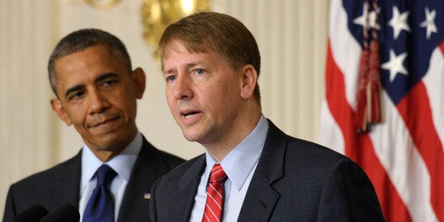 President Barack Obama, left, listens as Richard Cordray, right, the new director of the Consumer Financial Protection Bureau