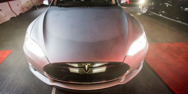 FILE - In this Oct. 9, 2014 photo, a guest test drives Tesla Motors' new version of its Model S sedan, the P85D, in Hawthorne