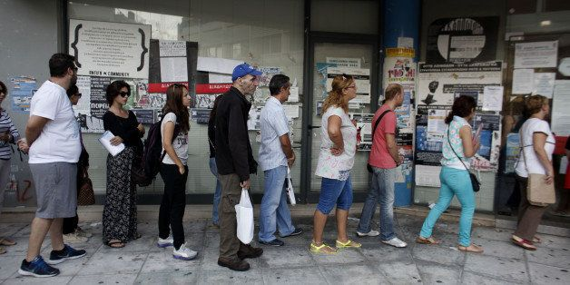 Jobseekers queue to enter an OAED employment center shortly after opening in Athens, Greece, on Wednesday, Sept. 10, 2014. Ov