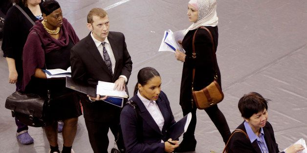 FILE - In this Oct. 8, 2014 file photo, job hunters line up for interviews at an employment fair sponsored by the New York St