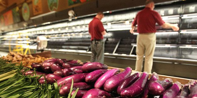 BOSTON - APRIL 23: Employees prepare the produce section for the opening of the new Wegmans opens in Boston. (Photo by Suzann