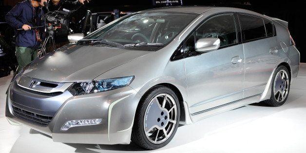 Cameramen video a customized Honda hybrid 'Insight Sports Modulo Concept' car at the Tokyo Auto Salon 2010 in Chiba, suburb T