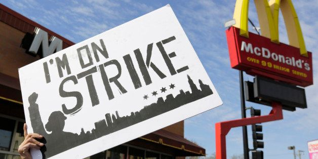 McDonald's workers and supporters rally outside a McDonald's, Wednesday, April 15, 2015, in Chicago. Fast-food workers callin