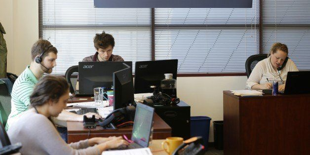 Sales representatives work Wednesday, April 15, 2015, at Gravity Payments, a credit card payment processor based in Seattle.