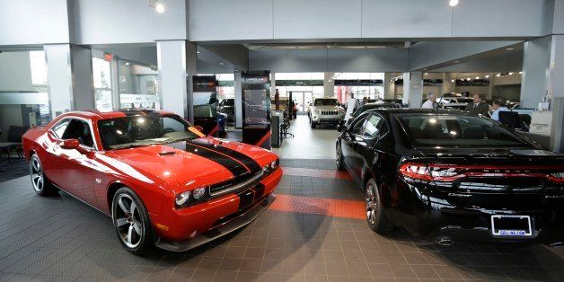 A Dodge Challenger, left, and a Dodge Dart are on display at the Golling Chrysler Dodge Jeep Ram dealership in Bloomfield Hil
