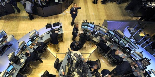 (FILES) File photograph dated May 6, 2010 shows traders on the floor of the New York Stock Exchange looking at stocks during