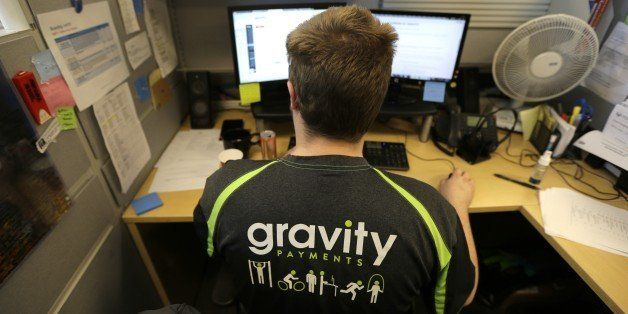 Austin Roos, a support team supervisor, works at his desk Wednesday, April 15, 2015, at Gravity Payments, a credit card payme