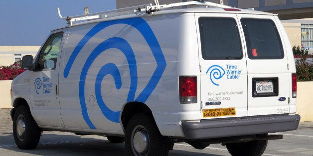 2007 (?) Ford E-250 van with Time Warner Cable's new livery. Gone are the plugs for TWC's various services, replaced by enlar